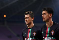 Cristiano Ronaldo Photos - Cristiano Ronaldo of Portugal warms-up ahead of the  International Friendly match between Portugal v Netherlands at Stade de Geneve on March 26, 2018 in Geneva, Switzerland. - Portugal v Netherlands - International Friendly