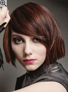 Metropolitan bob hairstyle with blunt cutting lines. The bangs are long and swept to the side.