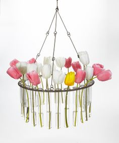 Test Tube Chandelier Flower Planter. I have a bunch of test tubes (I went through a test tube shot glass phase) that we can use to place tulips in. Not necessarily in a chandelier however