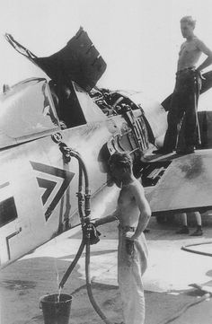 Refilling the German fighter Focke-Wulf Fw.190A-4 staff link from the 26th Fighter Squadron