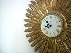 Vintage Mid Century Modern Gold StarBurst Syroco Clock. $175.00, via Etsy.