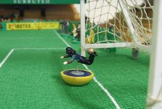 This Subbuteo art by Terry Lee is brilliant. Check out the different scenes featuring Rooney's overhead kick vs Man City, Nigel De Jong's Kung Fu kick from the 2010 World Cup and the classic scorpion kick by Rene Higuita from 1995 (pictured left). Table Football, Football Art, Football Boots, Nigel De Jong, Terry Lee, Baseball Field, Games, Scorpion, Beautiful
