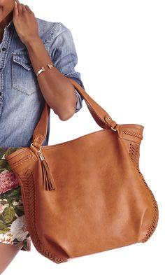 c6975253f76b Roomy tote bag with a slouchy shape, shoulder strap, braided side detailing  and a