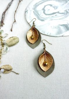 Leather bronze leaf earrings/metallic bronze dangle drop earrings/ gifts for her/christmas gift jewellery/fabric earrings. JE02-117 These pretty leather earrings are inspired by my love for nature & playing with fabric. Part of the new leather collection, inspired by a more neutral colour