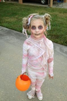 Little Pink Mummy | Scary and Cute Looks For Kids And Adults by DIY Ready at http://diyready.com/9-diy-mummy-costume-ideas/