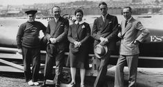 Joe Carstairs with (left to right) engineer Joe Harris, A B Ray, Captain Marshall and F B Beadle in front of her boat Estelle. (Photo by E. Bacon/Topical Press Agency/Getty Images)