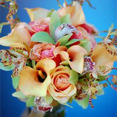 Bridal bouquet of Cherry brandy roses, calla lilies, cymbidium orchids and arachnid orchids.