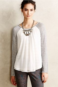A bit like a dressed up baseball tee. So easy to wear! Cadi Clipdot Pullover - anthropologie.com