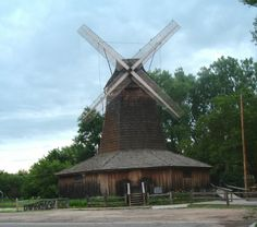 Charles G Schwarz and  and his brother immigrated from Germany to Smith County in 1869. They built the Dutch Mill in 1879. The mill began operation in 1883--corn meal, graham flour and wheat flour were made for home use and packaged to sell.