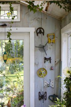Vintage sprinkler heads brighten a greenhouse wall.