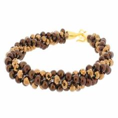 Kumihimo Bracelet - Summer Bronze  You must have a go at these bracelets, they are so easy to make and very pretty. They come with full instructions for you to use. I am sure all your friends will be asking you to make one, but don't tell them it only cost £4.99.