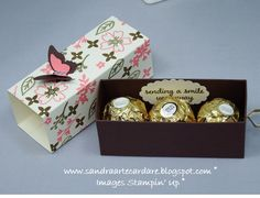 Sandra Ronald at ArteCardare, Independent Stampin' Up Demonstrator shows you how to make this great Ferrero Rocher Treat Box with ribbon pull and handmade Designer Series Paper with gold embossing. Visit my website above for the details Ferrero Rocher Box, 3d Templates, Envelope Punch Board, Treat Holder, Craft Box, Diy Box, Stamping Up, Gift Packaging, Craft Fairs