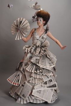 Portrait of a beautiful girl in a newspaper dress Stock Photo