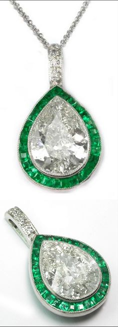 Here is a magnificent Art Deco platinum diamond and emerald pendant. The pendant is set with a pear shape diamond in the center accentuated by beautiful emeralds, and small round diamonds. The center diamond weighs approx 1.70ct. The approximate total weight of the emeralds is 0.81ct.