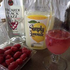 Cristy's Berry Lemonade- mix 10 oz Simply Lemonade, 5 oz Bacardi Black Razz, and a few slightly smashed raspberries. Serve with a bit of ice and enjoy!!!