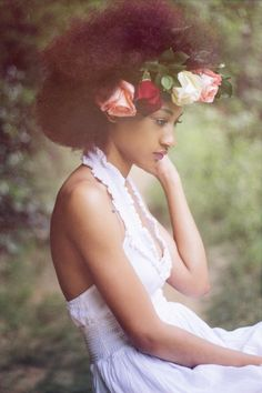 From the sun dress to the flowers in her hair, lovely