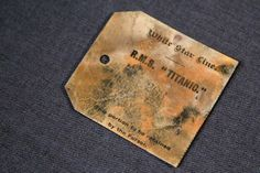 Titanic Sinking 100th Anniversary: RMS Titanic artifacts to be auctioned off A purser's tag from the RMS Titanic Inc. is on display at Guernsey's Auctioneers
