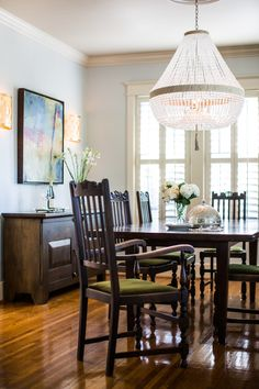 We love to mix not only old and new but styles too! This dining room features family antiques, contemporary art, and transitional lighting. Click the image to see more!  #interiordesign #collectiondesignlifestyle Transitional Style, Transitional Lighting, West End, Old And New, Dining Chairs, Dining Table, Dining Room Design, Traditional, Modern