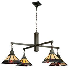 Craftsman chandelier with beige and red art glass.