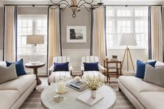 I love the lamp on the left. Neutral room with navy accents from The Inspired Room
