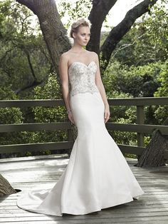 Style 2251 Willow by Casablanca Bridal. Willow is a breathtaking Fit and Flare gown that is straight out of a dream. The delicate bodice and sweetheart neckline shimmer with ornate hand beaded detailing, while the skirt remains perfectly simple. Matte Georgette fabric extends all the way through the chapel length train, making this gown an absolute stunner from top to bottom.