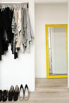 a home in copenhagen by the style files, via Flickr  Floor borads, yes. Yellow mirror, yes.