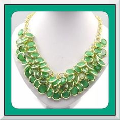 NEW Green Charm w/Gold Glam Statement Necklace This is a brand new statement green charm necklace/bib/choker. This is so unique because it has little green charms all over it accented with gold......Not too much of either one. This piece features an adjustable chain in gold tone as well. Really gorgeous! 🌺🌺PLEASE DO NOT PURCHASE THIS LISTING PLEASE COMMENT BELOW AND I WILL CREATE A SEPARATE LISTING FOR YOU TO PURCHASE! 🌺🌺 Boutique Jewelry Necklaces