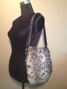 """Modified store made """"Roxanne"""" with beautiful rabbit chinchilla fur on black faux leather, adjustable strap. Visit our website fififurs.com to see this one and many more Beautiful Rabbit, Chinchilla Fur, Black Faux Leather, Furs, Website, Store, Fashion, Moda, Tent"""