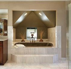 This bathtub is perfectly framed in this little  nook; it just oozes luxury! (Of course, the marble tile helps too!)