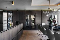 Poliform Artex in grey stained oak, integrated appliances from Gaggenau and Miele, tabletop in composite stone. Grey Stain, Bespoke Kitchens, Tabletop, Kitchen Design, Appliances, Stone, Furniture, Home Decor, Gadgets