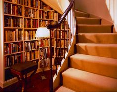 love the sneaky library nook under the winding stairs