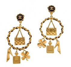 Extremely rare Vintage Chanel large iconic chandelier earrings.  It has Chanel's signature black and gold chain motif and a cc logo on the clip, lucky charms, coco perfume bottle, Chanel bag, clover and shoes. Signed 94C Chanel made in France.   Country: France  Period: 1994 C  Specifications: Total length:4.6 inches, width 2.5 inches $2500