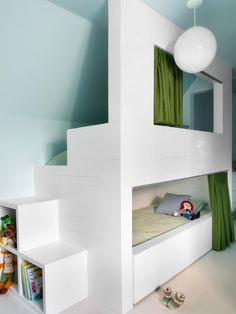 A built-in set of bunk beds is the star of this kids' room. Green cafe curtains provide privacy as well as a pop of color.