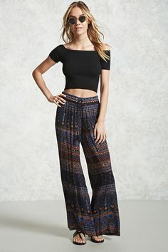 Crafted in a gauzy woven fabric, these pants feature a wide-leg silhouette, an abstract floral print, and an elasticized drawstring waist with tassels.