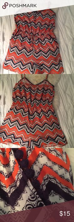 """Romper with tiny ball fringe and POCKETS! Orange, White, and Chocolate Brown zig zag print with the CUTEST tiny ball fringe at the neck and on both pockets! Elastic at the top of the back and all around the waist.?Tie at the waist is just decorative. Pit to pit 17"""" unstretched, 20"""" stretched. Waist elastic 15.5"""" unstretched and 21"""" stretched. Inseam 2.5"""". Waist to leg hem in front 14"""". Did I tell you this has roomy POCKETS??? Be Bop Other"""