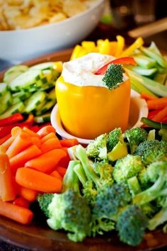 """I like to use crinkle-cut carrot chips, all colors of bell peppers, mushrooms, and other """"grownup"""" versions of veggies to amp up a veggie tray."""