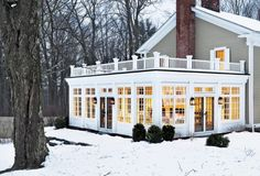 Love this sunroom  -- and it would look great on our house