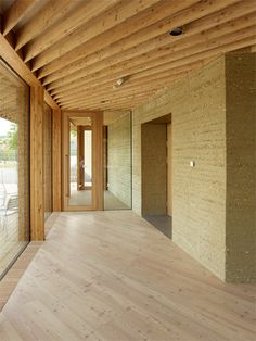 MLZD's lakeside bird-watching centre features rammed earth walls and an aviary