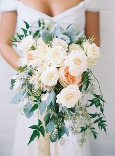 Romantic Cascade Bridal Bouquet of Roses | Austin Gros Photography on @CVBrides via @aislesociety