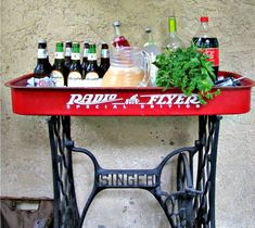 Radio Flyer Wagon repurposed :: Little Red Wagon :: old and vintage sewing machine :: Singer iron base :: combining Grandmother's machine with Mom's toy :: Party idea :: drink station inspiration Repurposed Furniture, Diy Furniture, Handmade Furniture, Furniture Plans, Modern Furniture, Furniture Design, Do It Yourself Upcycling, Decorating On A Dime, Old Wagons
