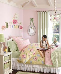 Beautiful room for a little girl, liking the font of the name and the flowers around it