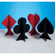 The Card Suit Centerpieces feature each of the four card suit icons - diamonds, hearts, spades and clubs. Each felt card suit table decorations measures 12 1/2 inches high