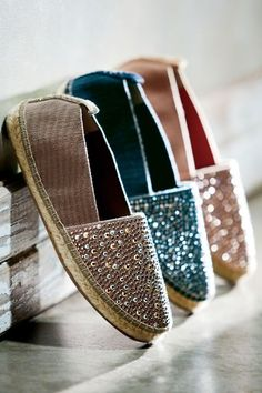 "If espadrilles are hot, this style is on fire, shimmering with metallic faceted studs. A mix of classic and modern details, they're expertly crafted in easy elastic fabric with hand-sewn whipstitching atop a 3/4"" jute-covered platform, soft jute footbed and rubber sole. Slip on everyday glamour with these essential espadrilles. Arlo Espadrilles - Item #1AN27"