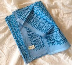 Light weight cotton sarong - another multi-use item (blanket, towel, skirt, cover-up, etc...) this photo isn't mine, I would go with a color that can go with the clothes I'm bringing.