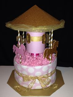 Carousel diaper cake that I created! Unique Diaper Cakes, Diy Diaper Cake, Nappy Cakes, Baby Shower Parties, Baby Shower Gifts, Baby Gifts, Recees Cake, Wiggles Cake, Lolly Cake