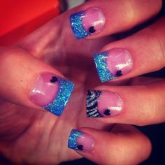 Acrylic Nails w/ a blue sparkly tip- zebra sparkly tip on 4th finger with little hearts