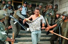 Israeli soldiers enjoying torturing a Palestinian; note the look on the victim's face, note how the soldiers seem to be having a great time.