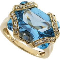 Radiant Cut Swiss Blue Topaz and Diamond Ring set in 14k Yellow Gold.  K&K Jewelers (=)