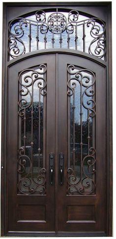 Elaborate iron door - I like this door without the top/crown piece.