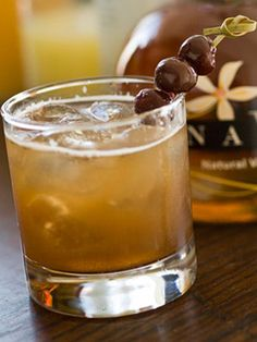 Vanille Bourbon  1/2 oz. tamarind syrup  1/2 oz. NAVAN Natural Vanilla Liqueur  1 1/2 oz. bourbon  1 oz. club soda    In a mixing glass add all ingredients except the soda, add ice, shake, and strain over fresh ice into a rocks glass. Add soda and garnish with 3 brandied cherries on a pick.
